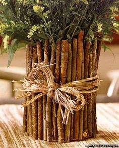 this is too cute. a coffee can and twigs... Really pretty and brings a natural look to your home