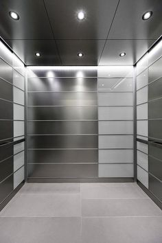 LEVELe-103 Elevator Interior with main panels in Stainless Steel, Seastone finish; accent panels in ViviChrome Chromis glass, White interlayer, Standard finish; Elevator ceiling with LED downlights and LED perimeter accent lighting; Rectangular Handrails at Nationwide Children's Hospital - Research Building III, Columbus, Ohio