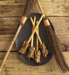 Witches Broom Sticks  Ingredients:  Grissini breadsticks or Sesame Seed Sticks  Mini Twiglets or Pretzels  String  Chives  Snap twiglets in half (or use mini ones) and attach to grissini sticks with string  Tie chives around them. It may be easier to tie the chives if you put them in a microwave for a few seconds so that they are more pliable.