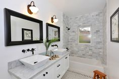 Love this bathroom! Don't like the sinks. Like the dark fixtures with lightness of the room.