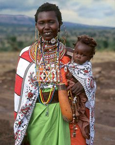 A Maasai woman and child in Tanzania wearing their finest clothing