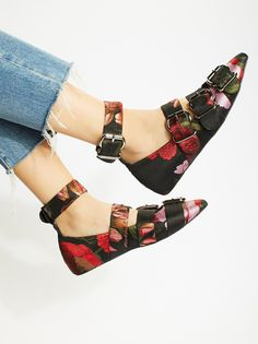 Poppy Fields Flat   Femme flat featuring a fabric design with statement buckles along the top of the foot.    * Adjustable fit