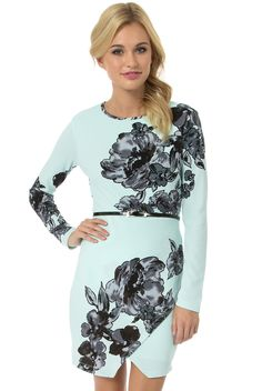 As seen on Lucy Hale in Pretty Little Liars!Designed by Teeze Me. The Longsleeve Floral Belted Envelope Dress features a round neckline, floral print, silk-like texture, keyhole back with tie, envelope hem and skinny black belt.CONTENT