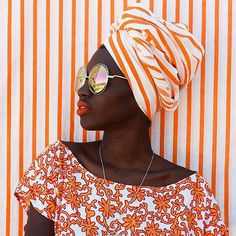 Perfectly coordinated in orange!  Photo: @loo_ana x @dresscoracao  #beauty #beautiful #blackisbeautiful #blackbeauty #africanfashion #fashionista #fashionhunter #naturalbeauty #ankara #orange #stylin  #colorful #colorfullife #stripes    @afroellemag