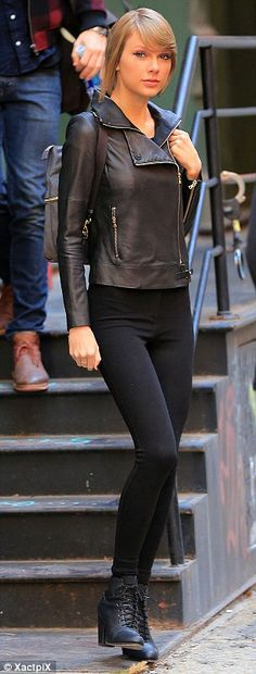 Stylish star: The singer wore a leather jacket over a tank top, and leggings tucked into heeled ankle boots