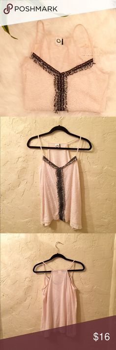 Anthropologie Blushed Lace Tank Check out the detailing on this lil number. It has gorgeous lace detailing on the front topped with a black and white knit going down the front of the blouse. The color is an off white/blush color- and it's been worn maybe once. Thanks for looking! Anthropologie Tops Tank Tops