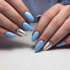 Blue, White and Black Studded Nail Art Design. The blue, black and white are always the best combo going, either its on your dress or on your nails. Stud it up with some rhinestones and you will love it.
