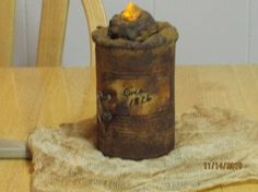 Grubby Grungy Fabric wrapped Candle both the top of can and tealight are done with.Hot glue ... Brown Paint and Dusted with Cinnimon.