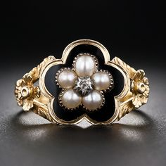 Georgian Pearl and Black Enamel Ring with tiny round locket compartment on the reverse.  England, mid-nineteenth century.