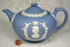 Wedgwood blue jasperware Queen Elizabeth II Coronation Teapot .. commemorating the 1953 coronation of Queen Elizabeth II, applied white profiles of the Queen and Price Philip on opposite sides and crowns, laurel leaf & berry wreaths, 1953, unglazed stoneware, UK