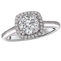 www.cmijewelry.com Cushion Style Halo Diamond Ring in 18kt White Gold. (D 1/4 carat total weight) 117808-100 18K Gold Romance - Halo Semi-Mount Ring, simple, solitaire with halo, double prong for round, princess and cushion cut, pave halo. Available at CMI Jewelry Showroom in Raleigh NC