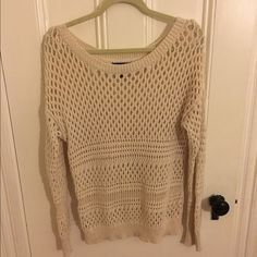 White/cream crochet oversized AE sweater Worn a handful of times! In great condition other than a small yellow paint stain on the sleeve. Barely noticeable. Has a hint of shimmer to it. American Eagle Outfitters Sweaters