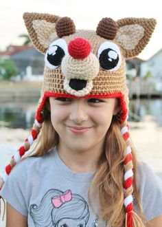 Rudolph the Red Nosed Reindeer had a very crochet nose! (oh, yes I did.)  New for Christmas this year, its my Rudolph the Red Nosed Reindeer Crochet Hat. Your loved one will adore this Rudolph crochet hat, perfect for a Christmas party or a holiday photo shoot. And in the winter months, your kid will be the talk of the class when he (or she!) shows up to school sporting this topper. Lets face it: this Rudolph crochet hat could just be the most fabulous piece of yarny goodness youll ever wear…
