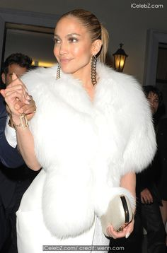 Jennifer Lopez leaves Lasserre restaurant in Paris wearing a white fur wrap http://icelebz.com/events/jennifer_lopez_leaves_lasserre_restaurant_in_paris_wearing_a_white_fur_wrap/photo2.html