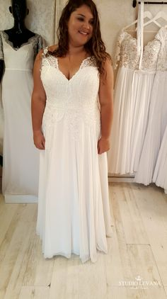 Real curvy bride in a plus size Chloe wedding gown from Studio Levana