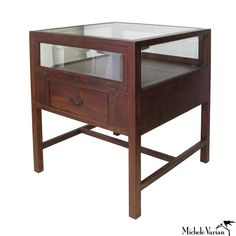 Vintage style teak wood and beveled glass showcase with 2 doors that flip down to access inside of case from both sides and 2 drawers for storage. This case is exceptional because it has a glass top a