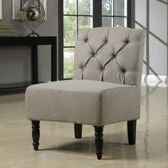 @Overstock - Materials: Wood, foam, fabric, hardware Finish: Espresso Upholstery materials: 100-percent polyesterhttp://www.overstock.com/Home-Garden/Lola-Seashell-Tufted-Armless-Chair/5992055/product.html?CID=214117 $124.99