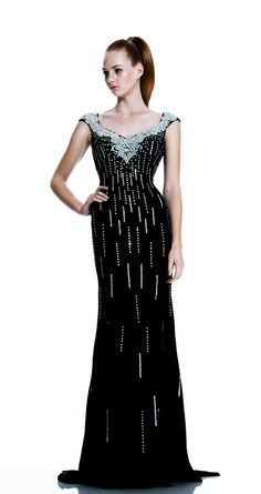 Size 2 Black- Johnathan Kayne 519 Cap sleeve floor length stretch jersey dress features a sequin bodice and back.
