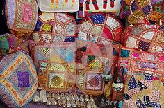 Many decorative pillows in a different raw