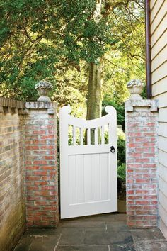 Updated Colonial Gate | Open or closed, garden gates always say welcome. Whether you opt for wrought-iron or classic white pickets, a gate can add character to your exterior design. #ClassicExteriorDesign #gardengates