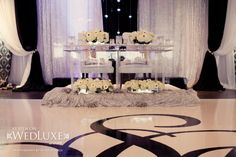 True Love, True Luxury: Shelley & Paul | WedLuxe Magazine www.weddingwowstoronto.ca floor white dance floor with s for bride and groom. Head table plexiglas with bling, led lights, with white flowers hydrangeas, roses, gerberas, peony, renunculus  in mirror glass vases back drop water fall in front on fabric, white, black and silver drapes, chairs white leather swarski crystal www.weddingwowstoronto.ca