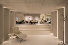 Holloways of Ludlow | bespoke concrete interior for leading Belgian retailer For the basement, the panels with lights.