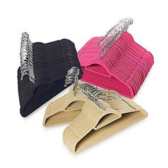 Enjoy space-saving functionality with these sleek suit hangers featuring a handy accessory bar for organizing belts, scarves, and ties. Velvety covering and flocked top keep clothes from slipping and securely in place.