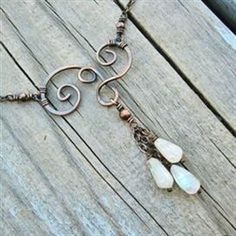 Moonstones and Antiqued Copper Swirled wire wrapped necklace by BearRunOriginals on Etsy #JewelryIdeas #wirejewelry