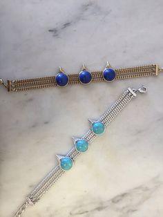 One bird, two bird, red bird, blue bird.   Beautiful bracelets by Jenny Bird.