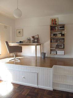 This is such a great idea for a dual purpose room - raise the floor and hide the bed in the office.