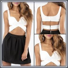 """White strapped padded cross cross top ➖SIZE: medium (see measurements)  ➖STYLE: Padded strapped white crop top that crosses into a unique pattern with back zipper. No bra required!   ➖MEASUREMENTS   ➖BUST: 15.75""""-17"""" (stretch)    ➖WAIST: 13.8""""-15.25"""" Tops"""