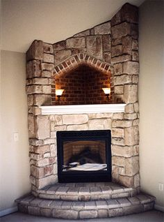 Corner Fireplace with Hearth. Cove lighting. Corner wood mantle with extended top into cove. Desert Tan Cut Cobble J&N Stone