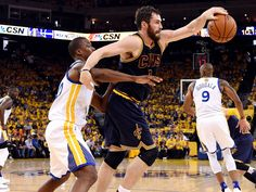 Cleveland Cavaliers forward Kevin Love (0) grabs a pass against Golden State Warriors forward Harrison Barnes (40) during the second quarter in game one of the NBA Finals at Oracle Arena.  Kyle Terada, USA TODAY Sports