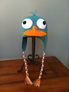 Perry the Platypus Inspired Hat with Earflaps and Braids.the semi-aquatic, egg laying mammal of action can now sit on your head. Yes, this is available in all size noggins, from babies to adults. (AddysHats on etsy) Crochet Crafts, Crochet Projects, Kids Hats, Children Hats, Perry The Platypus, Funny Hats, Phineas And Ferb, Disney Merchandise, Baby Hats