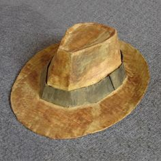 The fedora is the hat of gangsters and detectives, its distinctive form drawing us into the era from which it emerged. This iconic felt hat is what comes to mind when we hear of suchheroes asthe intrepid Indiana Jones. My son is currently mad about Indiana and so his 7th birthday will be themed accordingly. This year all the birthday guests will be requiring a fedora to face the Raiders of the Lost Birthday Cake. Nine fedoras to make and not a milliner in sight! I scanned ...