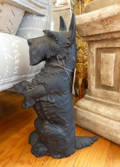Vintage Scottie Dog Door Stop...I own this, with a big RED BOW around his neck...LOVE IT!