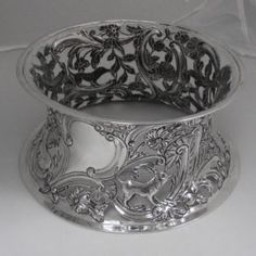 #Antique #Irish #Silver #Dish #Ring A truly beautiful, heavy gauge, Irish silver 'Dish Ring' (sometimes referred to as a #Potato #Ring ). History: Dish Rings are strongly associated with Ireland and became popular here from around 1740. Their purpose was to protect highly polished surfaces from heat. A hot bowl (perhaps filled with potatoes) would be placed on top of the dish ring. Made with piercing... Diamond Rings, Diamond Engagement Rings, Selling Antiques, Ring Dish, Unique Vintage, Piercing, Decorative Bowls, Ireland, Irish