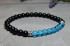 About the Bracelet Stunning aqua blue glass and black onyx mens gemstone bracelet. A flattering bracelet for a classic look. Bracelet Details: This mens bracelet is made with: - 6mm Black Onyx - 6mm A