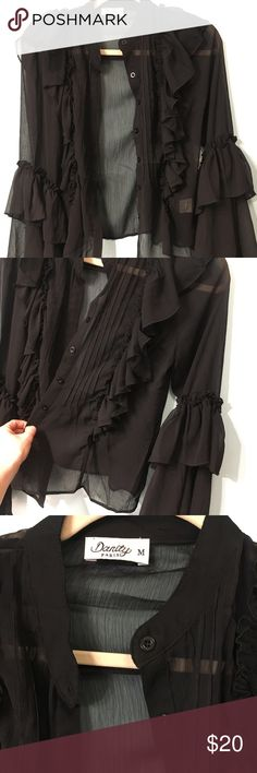 Nasty gal blouse BNWOT Ruffles. Never worn but tags removed. Black. Tops Blouses
