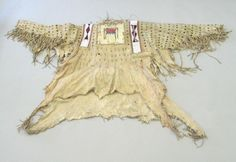 Blackfoot, Piegan (Native American). Chief's Dress Shirt, early 19th century. Hide, quills, hair, beads, pigment, cloth, cotton thread, 44 x 69 1/4 in. (111.8 x 175.9 cm). Brooklyn Museum, Henry L. Batterman Fund and the Frank Sherman Benson Fund, 50.67.5a. Creative Commons-BY (Photo: Brooklyn Museum, CUR.50.67.5a_view1.jpg)