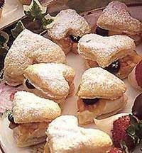 Ingredients:  * 1 (17.3-ounce) package frozen puff pastry (2 sheets)  * 1/3 cup peach spreadable fruit or preserves  * 1 teaspoon finely shr...