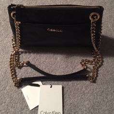 CALVIN KLEIN beautiful black leather. NWT. CALVIN KLEIN BLACK LEATHER - Great bag. NWT   Gold hardware.  Front pocket and back pocket.  Retail 168+ tax no trades.  Can also be worn as a crossbody. The leather on this is beautiful Calvin Klein Bags