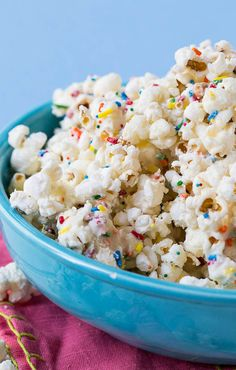 Recipe; cake batter popcorn 10 cups popped popcorn 8 ounces white bark or white chocolate ½ cup yellow cake mix ⅓ cup sprinkles 2 teaspoons nonpareils ~~
