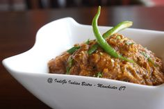 Phaal ( #DairyFree , #GlutenFree ), #spicy - Cooked in green and red chili sauce with onion tomato and spices
