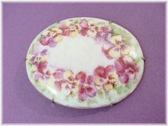 @@ FREE SHIPPING WITHIN USA @@  Victorian - 1880s Porcelain Hand Painted Purple Pansy 1 7/8 Brooch Pin - Gold Gilt Edge - Prong Set - Estate Antique - FREE SHIPPING. What A Rare Beauty! Stepping back into the Late 1800s, we discovered this Rare Treasure from a Pennsylvania Estate. With Delicate Hand Painting by a talented Artist, Beautiful Pansies formed on this Sweet Porcelain Oval Brooch. This Beauty measures 1 1/2 x 1 7/8 and features a Gold Gilt Painted edge prong set into ...