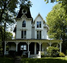 Brockville         Brockville is absolutely dripping with fabulous Victorian Villas. This one has Gothic Revival accents such as the trefoils and high ointed gables. It also has roundels, cornices and a Queen Anne style veranda.
