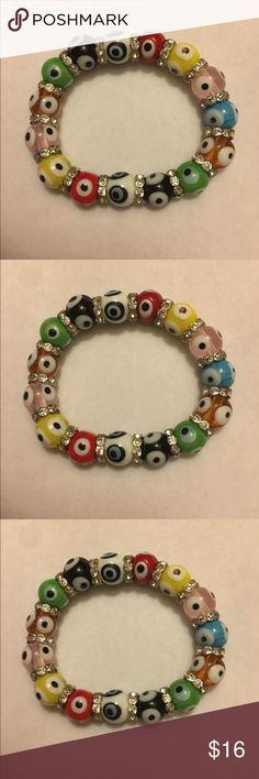 Evil eye bracelet This is a costume bracelet jewelry piece. I love it, because it looks like such a fun piece. Never worn. Jewelry Bracelets