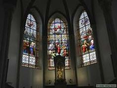 The stained glass windows in the front of the church.