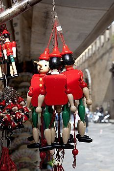 A classic trinket from Florence, Italy is their Pinocchio dolls. Pinocchio was written in 1883 by Carlo Collodi.
