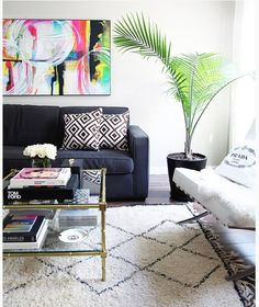 Adding plants into the space improves one's mood, cleans the air, and brings in life! I love how the plant and the art plays off of each other with the colors used. The neutral walls and furniture creates the perfect canvas.